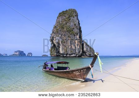Railay Beach, Krabi, Thailand - April 8 2015 Traditional Wooden Longtail Boat Anchored On Railay Bea