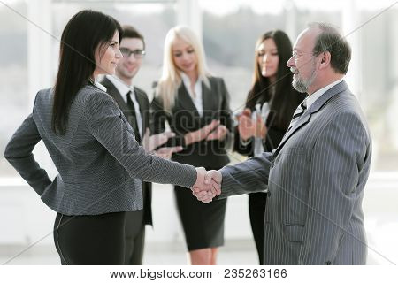 Handshake Of A Businessman And Business Woman.the Concept Of Cooperation