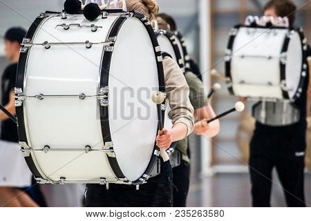 Musicians March, Play And Make Music With Large Bass Drums