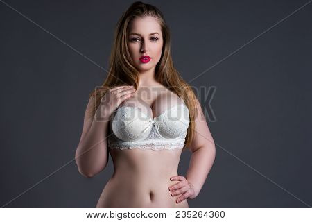 Plus Size Sexy Model In White Bra, Fat Woman With Big Natural Breast On Gray Studio Background, Over