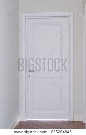 Closed White Interior Paint Door In Home Interior.