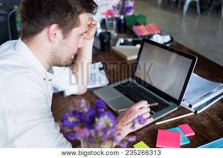 Caucasian Man Working On Laptop While Sitting At His Modern Office Place. Concept Of Young People Us