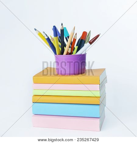 Stand With Pencils On A Stack Of Books .photo With Copy Space.
