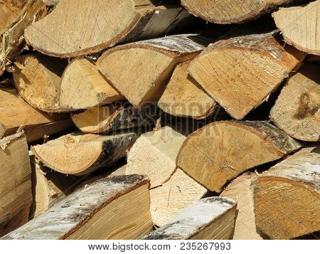 Chopped Birch Firewood In The Woodpile. A Bunch Of Firewood