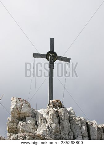 The Cross With Head Of Jesus On The Paternkofel Peak. The End Of Great Via Ferrata In Italy In Sexte