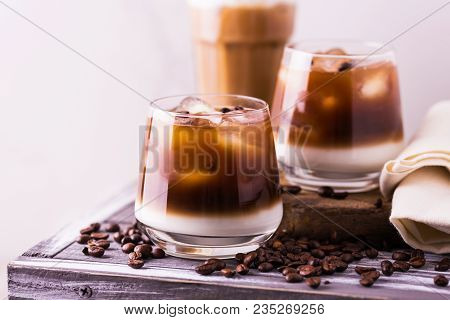 Iced Coffee In Glasses With Milk. Black Background