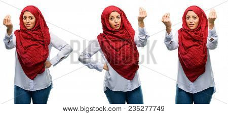 Arab woman wearing hijab angry gesturing typical italian gesture with hand, looking to camera isolated over white background