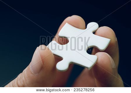 Discover Solution Or Strategy Missing Piece For Business Success Concept, Hand Holding A Bright Whit