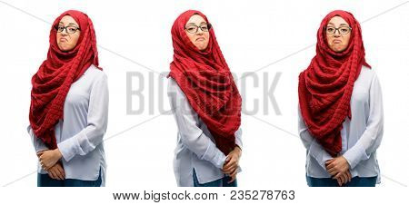 Arab woman wearing hijab having skeptical and dissatisfied look expressing Distrust, skepticism and doubt isolated over white background