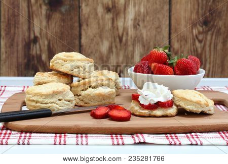 Ingredients For Making Strawberry Shortcake To Include Strawberries, Buttermilk, Biscuits And Whippe