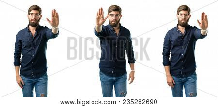 Young man with beard annoyed with bad attitude making stop sign with hand, saying no, expressing security, defense or restriction, maybe pushing isolated over white background