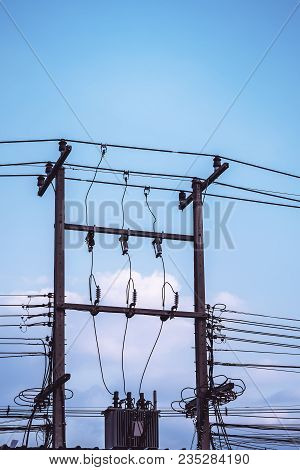 Electric Power In A Substation On Blue Sky Background, Electrical Substation Distributed To 220 Volt