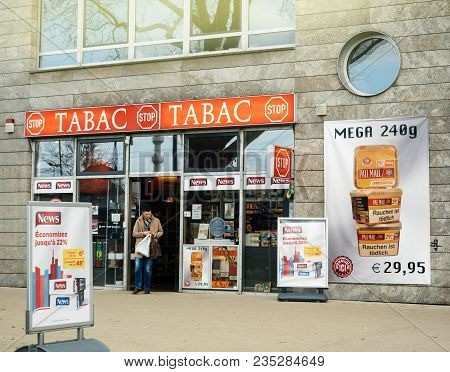 Kehl, Germany - Mar 29, 2018: Border Shopping - Man Exit German Taback Shop Offering Cheaper Than In
