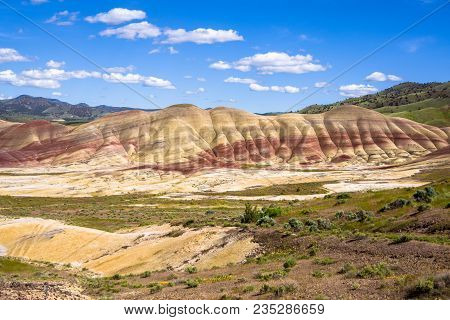 The Oregon Painted Hills. Bold Red Sandy Soil Makes Stripes Through The Hills, Alternating Red, Blac