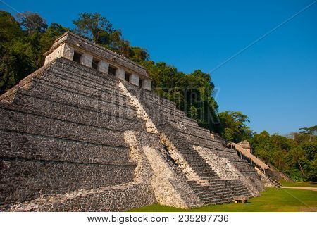 Ancient Ruins Of Palenque Against The Blue Sky, Maya City In Chiapas, Mexico