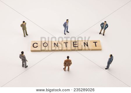 Miniature Figures Businessman : Meeting On Content Word By Wooden Block Word On White Paper Backgrou
