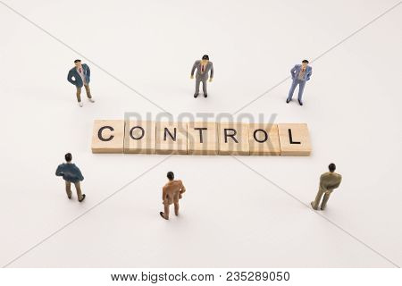 Miniature Figures Businessman : Meeting On Control Word By Wooden Block Word On White Paper Backgrou
