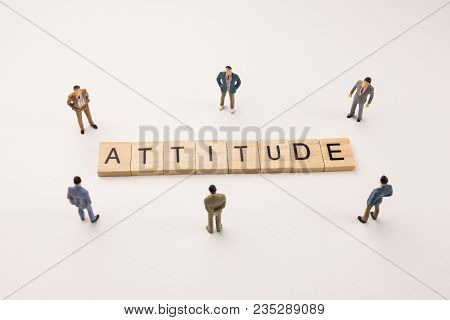 Miniature Figures Businessman : Meeting On Attitude Word By Wooden Block Word On White Paper Backgro