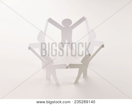 Closed Joining Of Five Paper Figure With Gray One In Hand Up Posture On Bright White Background. In