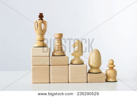 The Concept Of Career Development. Chess King At The Top Of The Career Ladder.