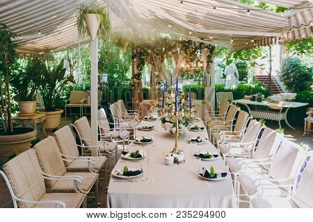 Beautiful And Exquisite Decoration Of The Wedding Celebration In In The Middle Of A Green Garden. Ba