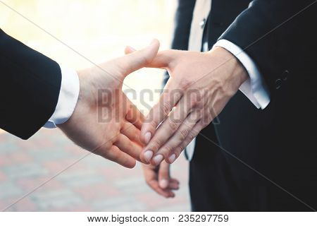 Close Up.two Businessman Holding Out Hand For Handshake.