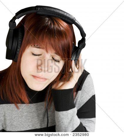 Pensive Girl Listening To Music