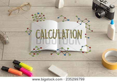 Open notebook on the floor with instruments on the floor and engeneering graph around