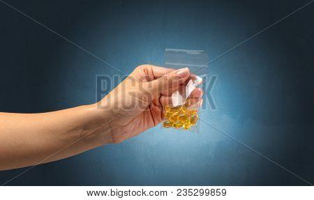 Naked, female hand giving drugs in plastic bag