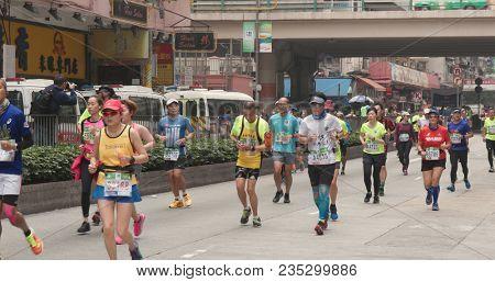 Causeway Bay, Hong Kong, 21 January 2018:- Hong Kong Standard chartered marathon, runner running in the street