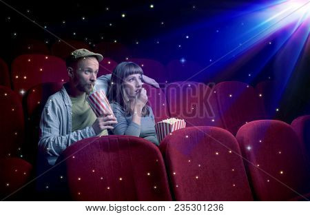Lovely couple watching 3D movie with little sparkling stars around