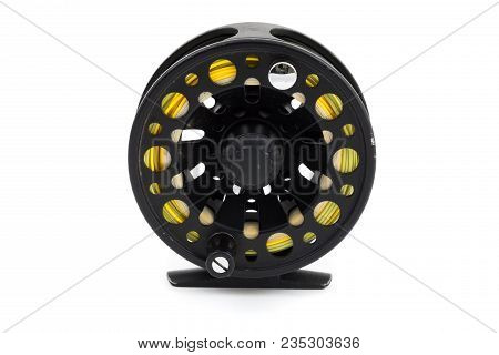 Fly Fishing Reel In Black With A Fly Line On It Ready To Go Fish On White Isolated Background In Stu