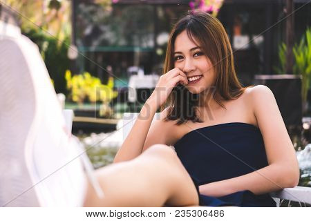 Portrait A Beautiful Woman: An Attractive Or Charming Woman Has A Nice Smile When A Beautiful Woman