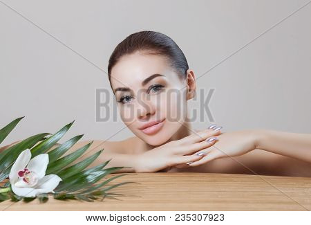 Portrait Of A Beautiful Woman In A Spa Salon In Front Of A Beauty Treatment. Professional Skin Care.
