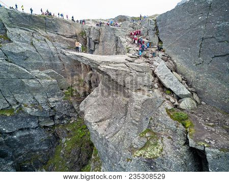 Trolltunga Or Troll Tongue Is A Rock Formation  At The Hardangerfjord Near Odda Town In Hordaland, N
