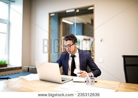 Intelligent Man Leadership Searching New Employee In Internet Via Laptop Computer While Sitting In O