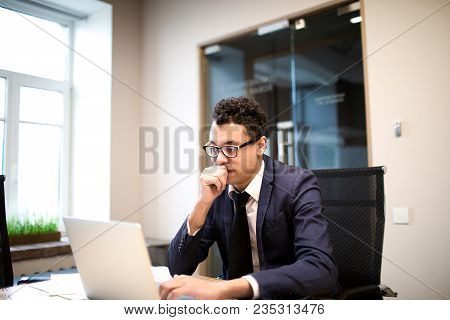 Man Proud Ceo In Glasses And Formal Suit Monitors Financial Market Via Laptop Computer, Sitting In M