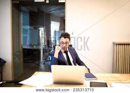 Confident Man Executive Director In Luxury Suit Read On Laptop Computer Monthly Income Of His Compan