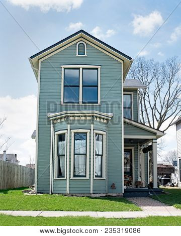 Narrow Blue House with Bay Window