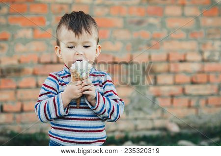 Little Cute Boy Boy Boy Three Years Eating Ice Cream Very Appetizing On Brick Wall Background