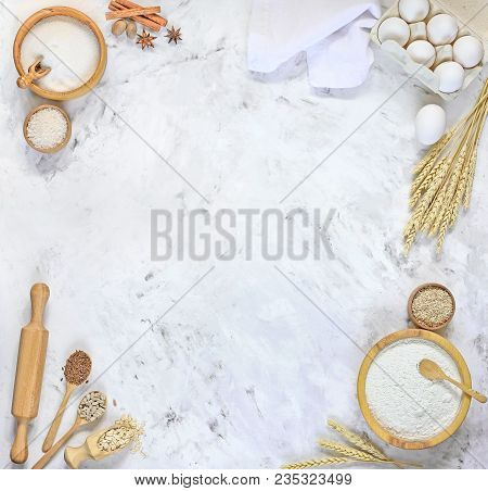 Ingredients For Making Dough For Bread, Pizza, Cake, Biscuit On White Kitchen Table. The View From T