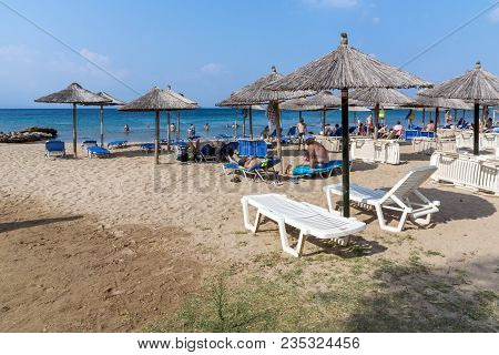 Chalkidiki, Central Macedonia, Greece - August 25, 2014: Seascape Of Blue Dolphin Cove Beach At Sith