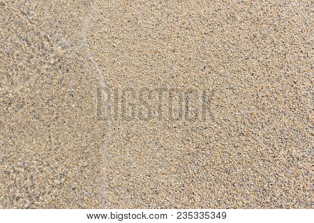 Sand Texture. Sandy Beach For Background. Soft Wave Of The Sea On The Sandy Beach