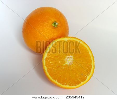 Ripe Orange And Its Half. Isolated In A White Background
