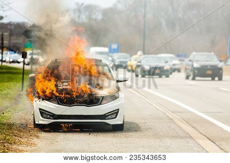 Burning Car On Fire On A Highway Road Accident