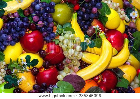 Colofrul Background Of Different Fruits - Bananas, Grapes, Apples, Oranges