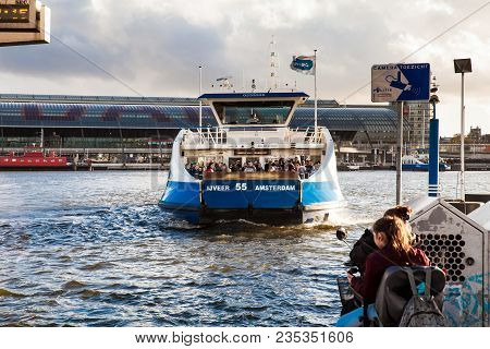 Amsterdam, Netherlands - April, 2017: Ferry Cruise Boat In Amsterdam City, Holland