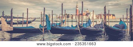 Berth With Gondolas In Summer, Venice, Italy. Gondola Is A Traditional Romantic Transport In Venice.