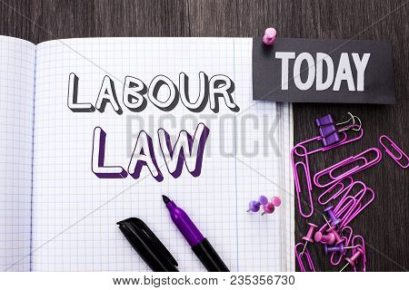 Handwriting text Labour Law. Concept meaning Employment Rules Worker Rights Obligations Legislation Union written Notebook Book wooden background Today with Thumbpin Marker Paper Clip. poster