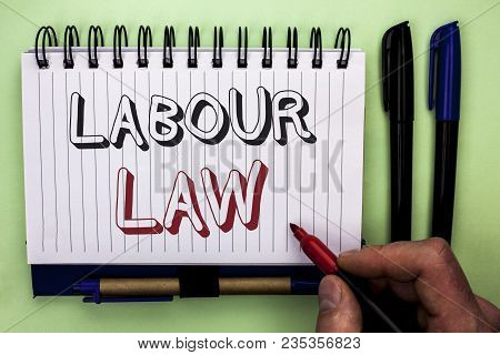 Writing note showing  Labour Law. Business photo showcasing Employment Rules Worker Rights Obligations Legislation Union written by Man Holding Marker Nootbook Book plain background Marker. poster